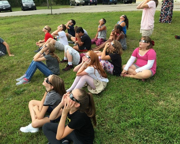 Students observing the solar eclipse